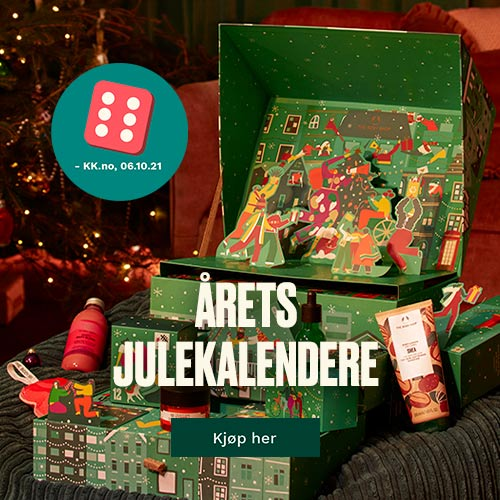 Stor julekalender med skuffer og produkter inni med terningskast seks på. Foto